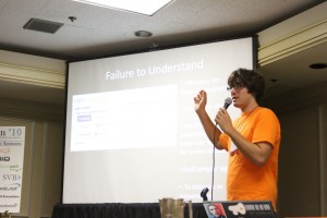 Evan Hamilton in front of a screen with the title failure to understand